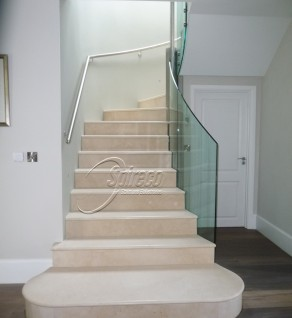 Marble Clad Stairs with Glass Balustrade