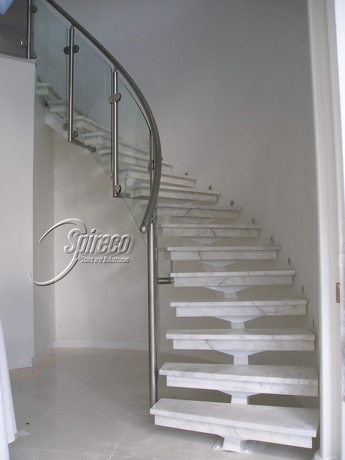 Curved stairs balustrades spireco spiral stairs for Curved stair case